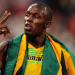 Усэйн Болт бьет на пекинской Олимпиаде-2008 рекорд на стометровке