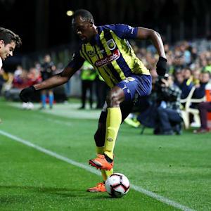 Usain Bolt controls the ball