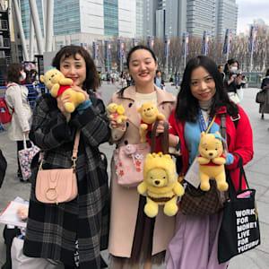 Yuzuru Hanyu fans pose with Pooh toys at the World Figure Skating Championships