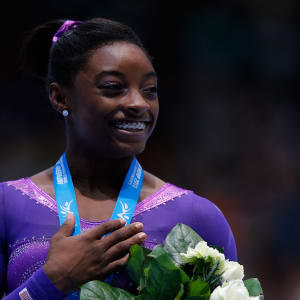 Simone Biles smiles during the vault award ceremony at the 2013 World Championships.