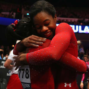 Simone Biles and Gabby Douglas embrace after taking gold and silver in the all-around at the 2015 Worlds