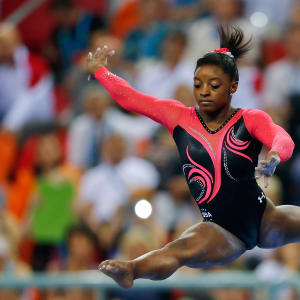 Simone Biles leaps on beam during the apparatus final at the 2014 Worlds