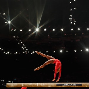 Simone Biles tumbling on the balance beam during the all-around final at the 2015 Worlds