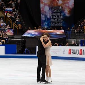 Victoria Sinitsina and Nikita Katsalapov hug on ice after their free dance