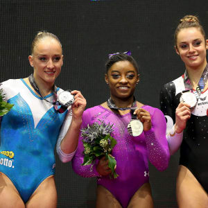 Sanne Wevers (left), Simone Biles (center) and Pauline Schafer (right) share the beam podium at the 2015 Worlds