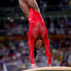 RIO DE JANEIRO, BRAZIL - AUGUST 14: Simone Biles of the United States competes in the Women's Vault Final on Day 9 of the Rio 2016 Olympic Games at the Rio Olympic Arena on August 14, 2016 in Rio de Janeiro, Brazil. (Photo by Ryan Pierse/Getty Images)