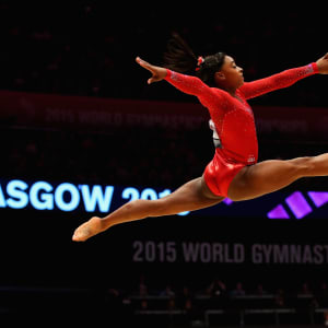 Simone Biles leaps during the all-around final at the 2015 Worlds