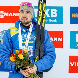 Alexander Loginov takes third place during the IBU Biathlon World Cup Men's Sprint in Pokljuka, Slovenia.
