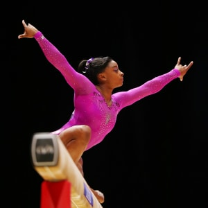 Simone Biles poses during the beam final at the 2015 Worlds