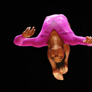 Simone Biles flips during the beam final at the 2015 Worlds