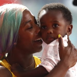 Shelly-Ann Fraser-Pryce of Jamaica celebrates with her son Zyon after winning the Women's 100 Metres final during day three of 17th IAAF World Athletics Championships Doha 2019 at Khalifa International Stadium on September 29, 2019 in Doha, Qatar. (Photo by Alexander Hassenstein/Getty Images for IAAF)