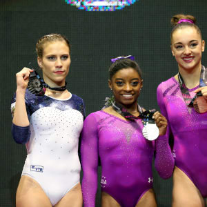 Ksenia Afanasyeva (left), Simone Biles (center) and Maggie Nichols (right) share the floor exercise podium at the 2015 Worlds