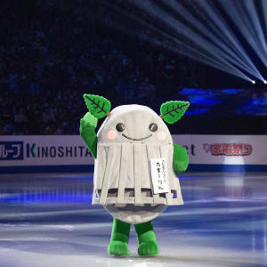 Tamarlin, the mascot, on ice during the exhibition gala