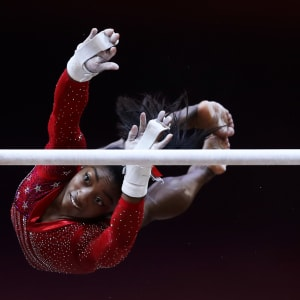 Simone Biles performs on the uneven bars during the team final at the 2018 Worlds