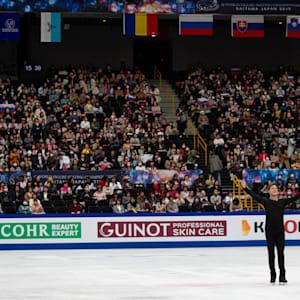 Victoria Sinitsina and Nikita Katsalapov react on ice after their free dance