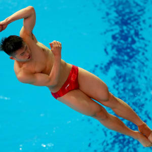 Zongyuan Wang of China competes in the Men 1m Springboard preliminary round on day one of the Gwangju 2019 FINA World Championships at Nambu International Aquatics Centre on July 12, 2019 in Gwangju, South Korea. (Photo by Clive Rose/Getty Images)