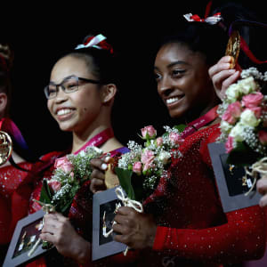 Ragan Smith (left), Morgan Hurd (center) and Simone Biles (right) smile after winning team gold at the 2018 Worlds
