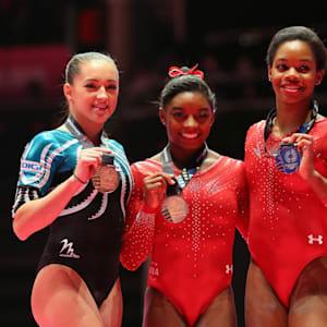 Larisa Iordache (left), Simone Biles (middle) and Gabby Douglas (right) share the women's all-around podium in 2015