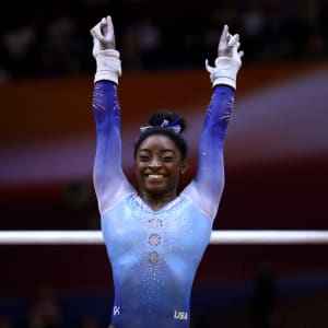 Simone Biles salutes during the uneven bars final at the 2018 Worlds