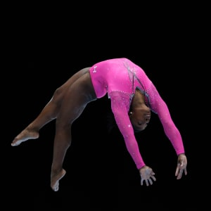 Simone Biles tumbles during the beam final at the 2013 Worlds.