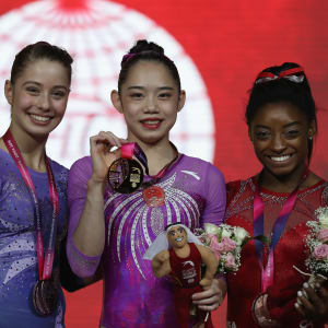 Ana Padurariu (left), Liu Tingting (center) and Simone Biles (right) share the balance beam podium at the 2018 Worlds