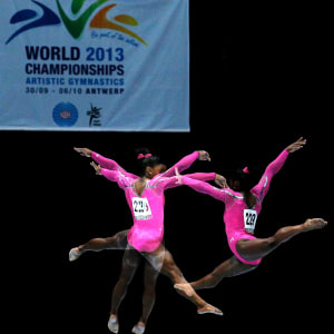 Image sequence of Simone Biles' balance beam final routine.