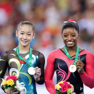 Bai Yawen (left), Simone Biles (middle), and Aliya Mustafina (right), claimed the balance beam medals at the 2014 Worlds