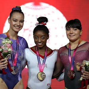 Shallen Olsen (left), Simone Biles (center) and Alexa Moreno (right) share the women's vault podium at the 2018 Worlds