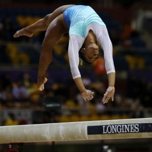 Simone Biles tumbles on the balance beam during the all-around final at the 2018 Worlds