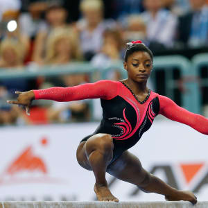 Simone Biles poses on beam during the final of the 2014 World Championships in Nanning, China