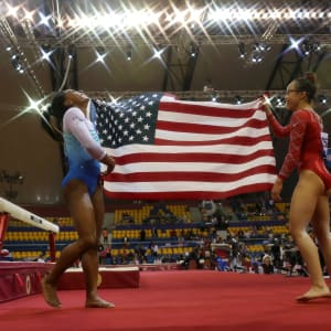 Simone Biles (left) and Morgan Hurd (right) share a laugh after taking gold and bronze in the all-around at the 2018 Worlds