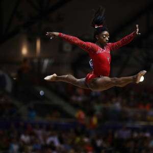 Simone Biles leaps during the balance beam final at the 2018 Worlds