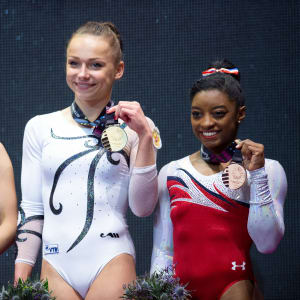 Hong Un-Jong (left), Maria Paseka (middle) and Simone Biles (right) share the vault podium in 2015 (John Cheng/USA Gymnastics)