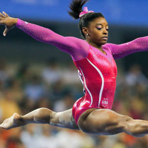 Simone Biles leaps during the all-around final at the 2014 Worlds