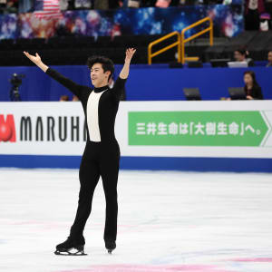 Nathan Chen waves to the crowd after his short program at 2019 Worlds