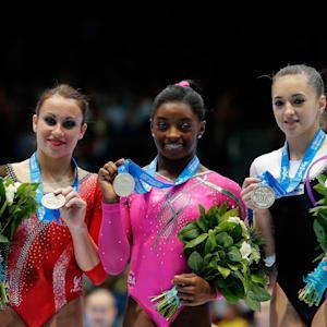 Simone Biles wins floor gold in 2013. Italy's Vanessa Ferrari, left, was the silver medalist. Romania's Larisa Iordache took bronze.
