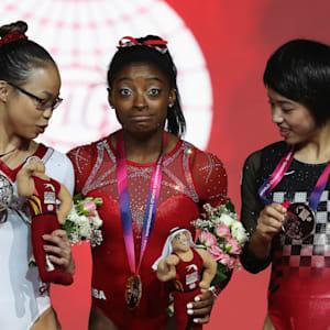 Morgan Hurd (left), Simone Biles (center) and Mai Murakami (right) share the women's floor podium at the 2018 Worlds
