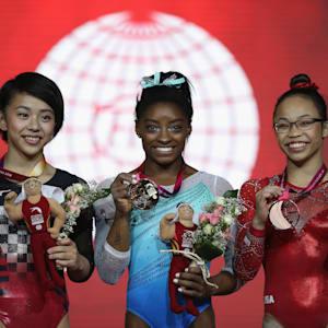 Mai Murakami (left), Simone Biles (center) and Morgan Hurd (right) share the women's all-around podium at the 2018 Worlds