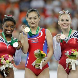 Simone Biles (left), Hong Un-Jong (middle) and MyKayla Skinner (right) share the vault podium at the 2014 World Championships