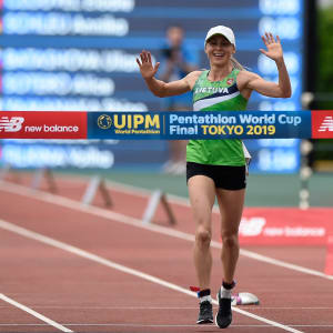 Laura Asadauskaite celebrates victory at the end of the Laser Run