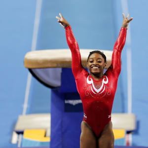Simone Biles salutes after vaulting at the 2014 Worlds