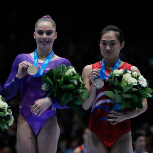 Simone Biles wins vault silver at the 2013 Worlds. McKayla Maroney (USA), center, wins gold while Hong Un-Jong (PRK) takes bronze.