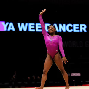 Simone Biles waves after her performance in the floor final at the 2015 Worlds