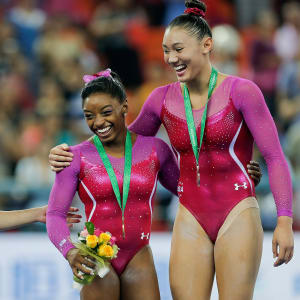 Larisa Iordache (left), Simone Biles (middle) and Kyla Ross (right) share a laugh during all-around awards at the 2014 Worlds