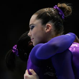 Simone Biles shares a hug with Olympic champion McKayla Maroney during the vault awards ceremony at the 2013 World Championships
