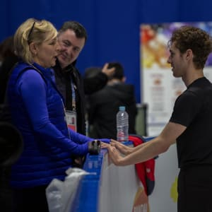 Jason Brown speaks to coach Tracy Wilson in practice as Brian Orser watches on