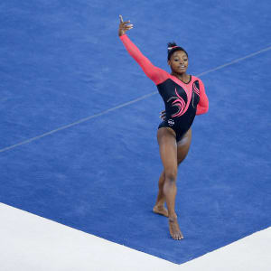 Simone Biles poses on floor during the apparatus final at the 2014 Worlds