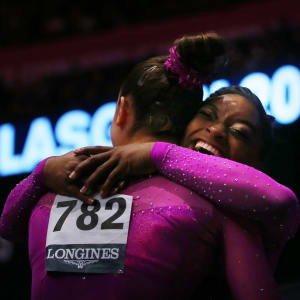 Simone Biles and Maggie Nichols embrace after finishing first and third in the floor final at the 2015 Worlds