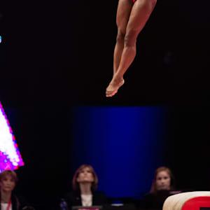 Simone Biles midair during the vault final at the 2015 Worlds (John Cheng/USA Gymanastics)