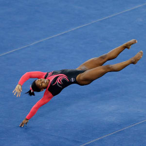 Simone Biles competes on floor during the apparatus final at the 2014 Worlds